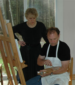 leah kristin dahlgren teaching one of her art classes with student doug challenger